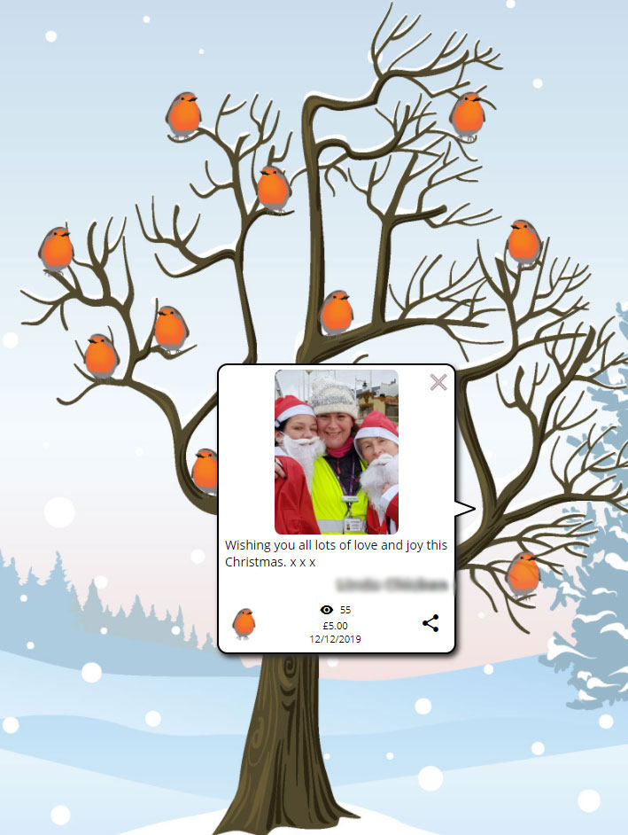 image shows a robin on a tree, with a Christmas message from a colleague to her team